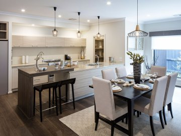 <p>This charming open plan living area seamlessly connects the dining and kitchen areas.</p>