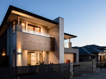 <p>This beautiful home features a dramatic and commanding facade.</p>