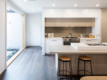 <p>A modern, stylish kitchen features at the heart of this home.</p>